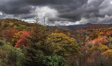 north cascade national park: Dark Clouds Above Graveyard Fields as leaves change in autumn
