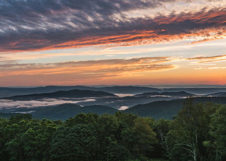 settles: Fog Settles into Valley at Sunset in Shenandoah valley Stock Photo