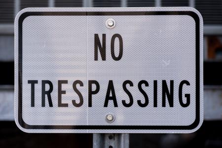 No Trespassing Sign in White and Black Banco de Imagens