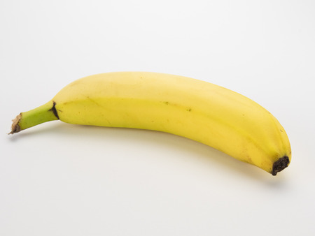 Banana on its side isolated on white Banco de Imagens