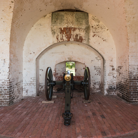 tybee island: Cannon Aiming Through Wall of Historic Fort Stock Photo