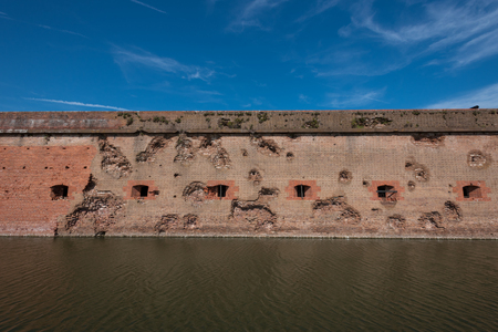 tybee island: Damaged Wall and Moat at Fort Pulaski with blue sky