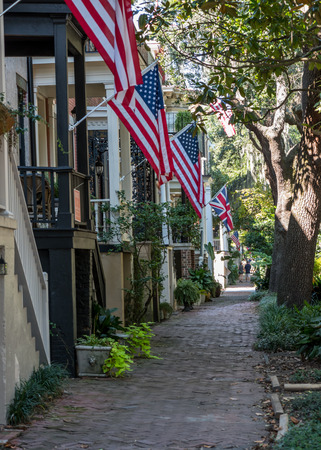 porch scene: Flags on Jones Street in Savannahs historic residential district