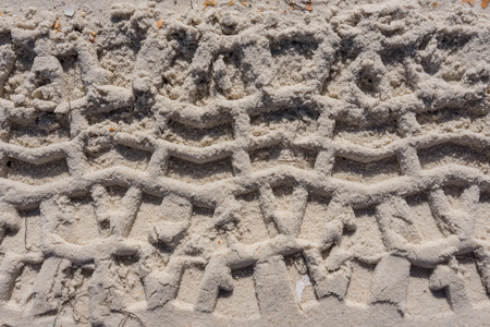 treads: Thick Tire Treads in Sand Background Image Stock Photo