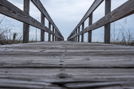 low angle: Low Angle View of Boardwalk over Dunes leads to the gulf coast