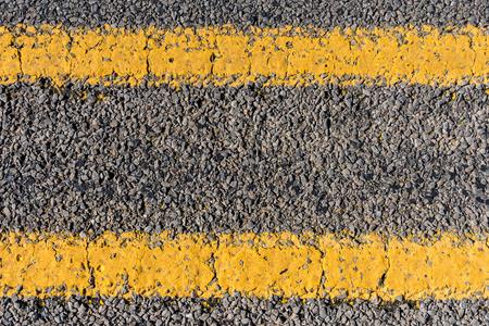 Worn Yellow Stripe on Texas Highway background image Imagens