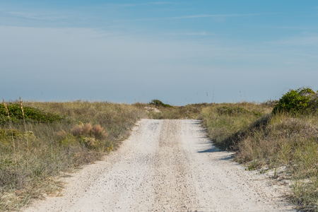 Dirt Road Rolls Over Sand Dunes along Florida gulf coast