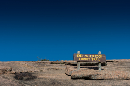 Enchanted Rock Summit Sign against clear blue sky Stock fotó