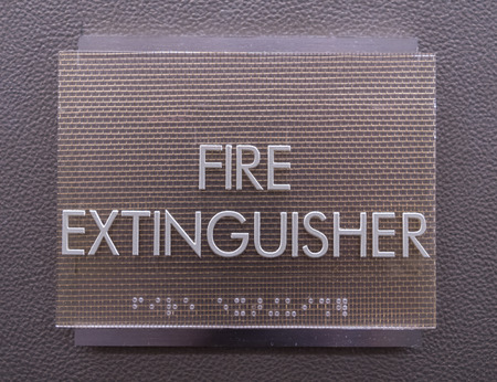braille: Modern Fire Extinguisher Sign on faux leather wall