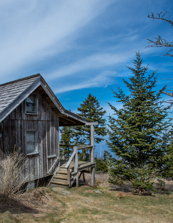 cirrus: Cirrus Clouds Above Weathered Cabin in mountains