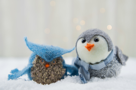 Felt Owl and Bird in Snow with subtle bokeh background Stock Photo