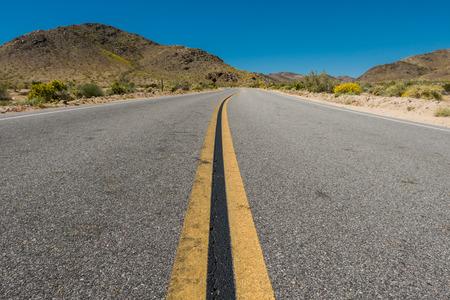 Winding Road Through Desert Terrain in southern California Imagens