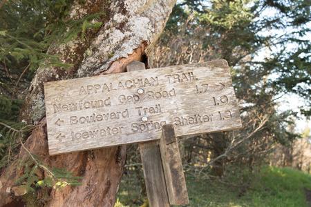 appalachian: Appalachian Trail Distance Sign Leans Against Tree