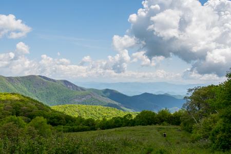 appalachian: Tiny Hiker on the Trail Down Siler Bald along the Appalachian Trail
