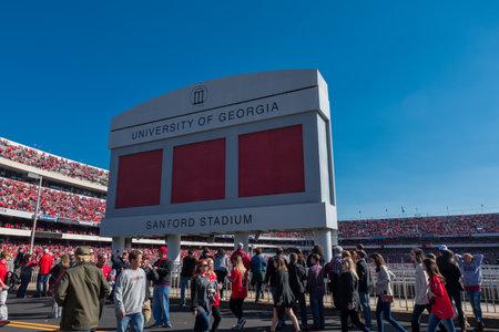 Athens, Georgia, United States: November 26, 2017: Crowd passes under Sanford Stadium Sign on Game Day