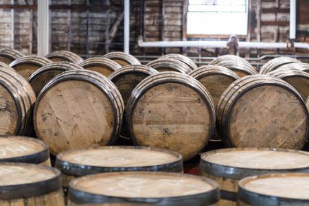 Bourbon Barrel Storage Room with barrels standing and rolling Archivio Fotografico