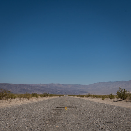 Wide Shot of Desert Road Through Mountains in Utah