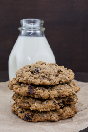 Oatmeal Raisin Cookies in Stack with Jar of Milk in Background
