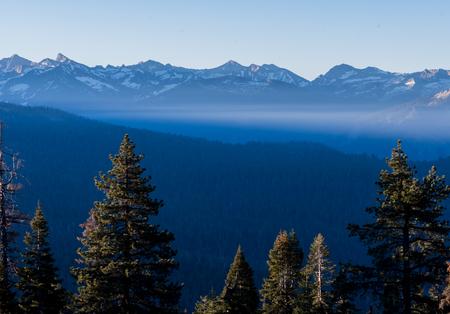 Wispy Fog in Front of High Sierras Range in California Stock Photo