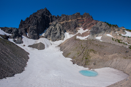 Glacial Tarn Underneath Three Fingered Jack in central Oregon