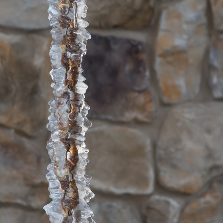 Thick Ice on Rain Chain froze over in winter Stock Photo