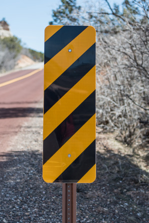 rectangle: Caution Sign on Side of Road in desert