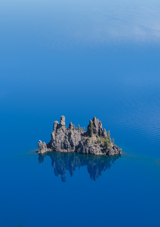 crater lake: Phantom Ship in Crater Lake vertical with blue water above
