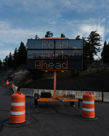 crater lake: Road Work Ahead Trailer Sign during summer construction season Stock Photo