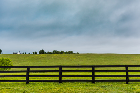 wispy: Section of Horse Fence and Copy Space Above over wispy clouds