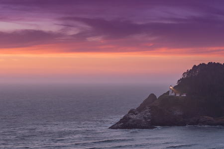 Purple Sunset Over Heceta Head Lighthouse Stock Photo