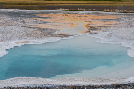 Hot Springs pool in Yellowstone flows into sulfur trail