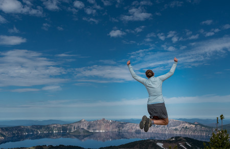 Woman Leaps at Overlook to Crater Lake on Quiet Morning