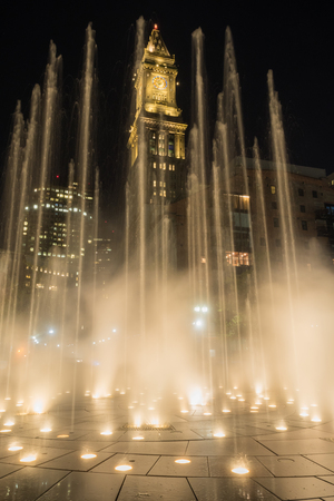 Fountain Blasts Upward as Custom House Tower Looms Behind