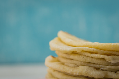 Detail on Homemade Tortillas with copy space over blue background Stock Photo