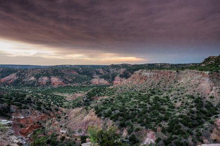Storm Clouds and Sunset Over Palo Duro in west Texas Stock Photo