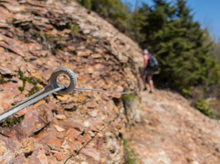 Safety Wire Strung Along Rocky Trail with Steep Dropoff