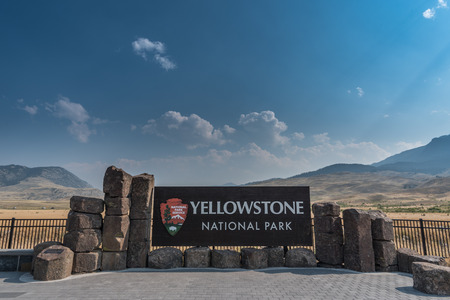 Yellowstone National Park Sign with Cloudy Blue Sky