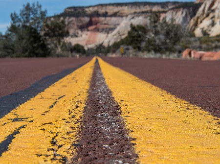 Stripe of MIddle of Red Paved Road in Desert wilderness