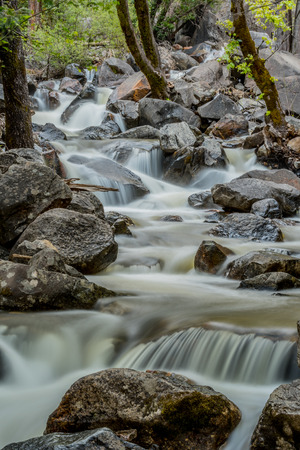 Water Rushes Away from Bridleveil Falls in California mountains