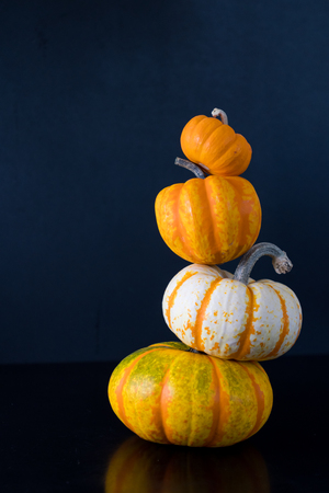 Jack Be Little Pumpkin Tops Pumpkin Tower on dark background Stock Photo