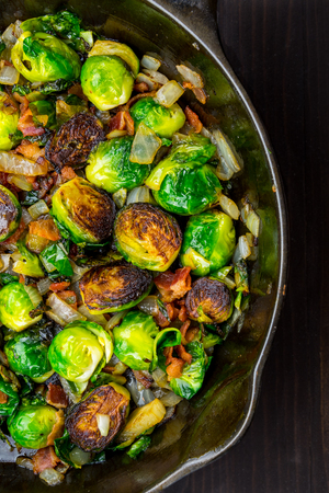 Half View of Roasted Brussels Sprouts and Bacon in Cast Iron Skillet