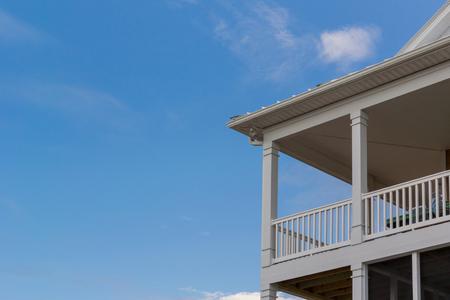 A beach house near the Atlantic Coast has balconies overlooking the ocean Stock Photo