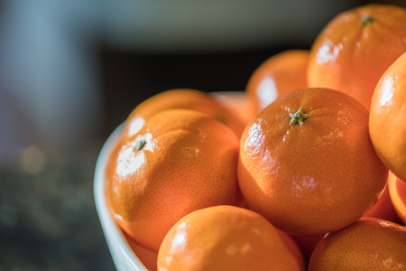 Mandarine Oranges in a Bowl with sunlight