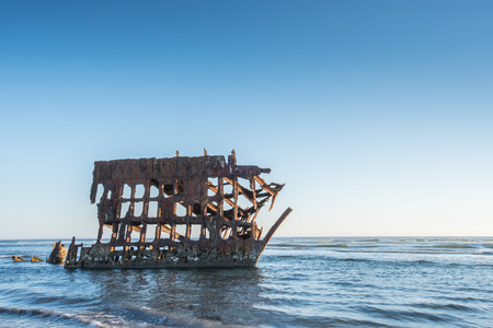 Wreck of Peter Iredale in late afternoon light Stock Photo