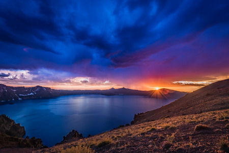Sunburst Over Crater Lake on Stormy Night