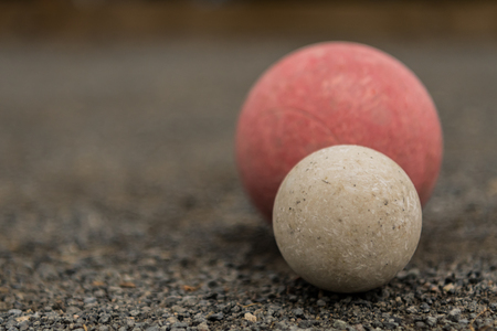 White Bocce Ball with Red Ball Close Copy Space Left Stock Photo