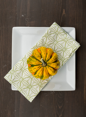Acorn Squash on Napkin and Square Plate on wooden table