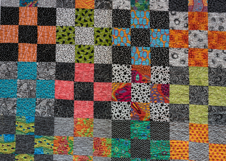 Black and White Themed Quilt with Accent Colors Foto de archivo