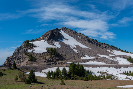 Snow Lingers on the Trail to Watchman Overlook in Crater Lake Stock Photo