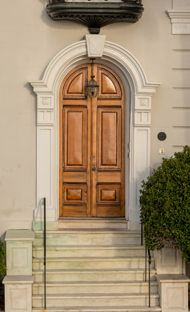 Arching Wooden Door on Old House in historic district